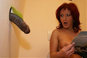 Redhead MILF milks a big black cock at a gloryhole on blacks on cougars blog