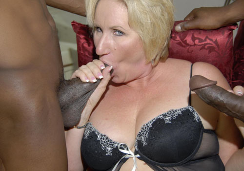 Blonde mature lady sucks off two giant black cocks on blacks on cougars blog